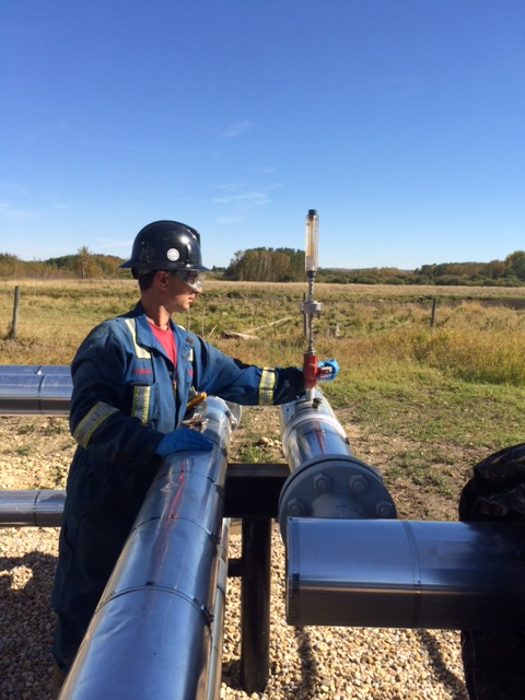 A Contact field representative conducting on-site well tests